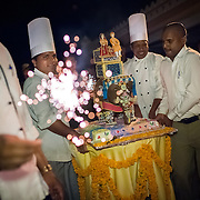 A wedding cake in the shape of an elephant is brought out at a lavish wedding in Udaipur.