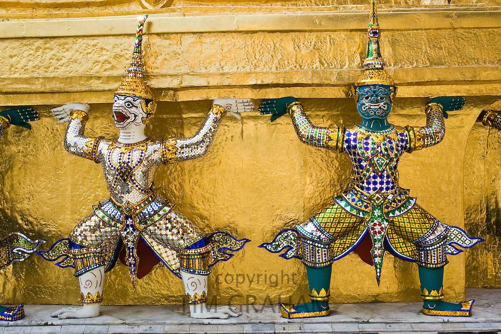 Guardian sculptures at the base of a Golden Chedis, Bangkok, Thailand