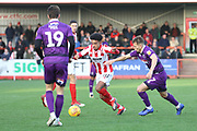 acob Maddox and Jake Hessenthaler  during the EFL Sky Bet League 2 match between Cheltenham Town and Grimsby Town FC at LCI Rail Stadium, Cheltenham, England on 8 December 2018.
