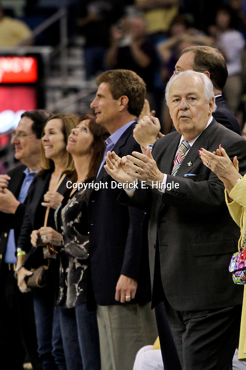April 19, 2012; New Orleans, LA, USA; New Orleans Hornets and Saints owner Tom Benson cheers courtside during overtime against the Houston Rockets at the New Orleans Arena. The Hornets defeated the Rockets 105-99.   Mandatory Credit: Derick E. Hingle-US PRESSWIRE