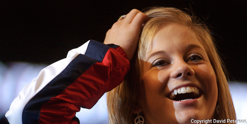 "Olympian Shawn Johnson shares a light moment at her homecoming Tuesday, August, 26, in Des Moines, Iowa.  Johnson's homecoming was attended by over 7,000 fans who filled the Wells Fargo Arena in Des Moines.  Johnson showed off her four Olympic medals, including a gold for the balance beam.  The city of Des Moines declared the month of September ""Shawn Johnson Month"".  As one of the most recognizable faces of the Beijing Olympics, Johnson has been on a whirlwind post Olympics tour, which has included an appearance on The David Letterman Show.  She will also appear on Jay Leno, and will lead the Pledge of Allegiance at this year's Democratic Convention."