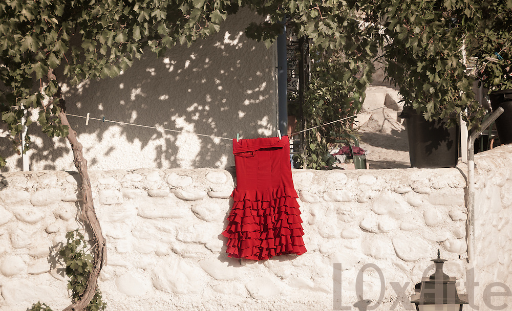 Red Flamenco skirt hangs to dry in the sun in Granada, Spain. The image is available for commercial licensing through Arcangel Images. ID# AA1644969 . Contact LOxArte for Fine Art Prints.