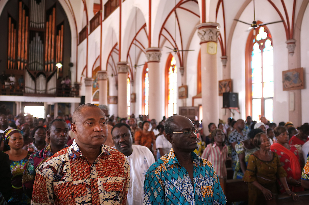 LOME, TOGO  13-02-14   -  One month after fire engulfed Lome's Grand Marche, Togolese opposition members gathered the Cathedral du Sacre Coeur, a block away from the Grand Marche, to pray for the shopkeepers who lost everything in the blaze. At left is prominent opposition figure JP Fabre. Photo by Daniel Hayduk