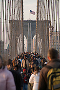 people walking across the Brooklyn Bridge
