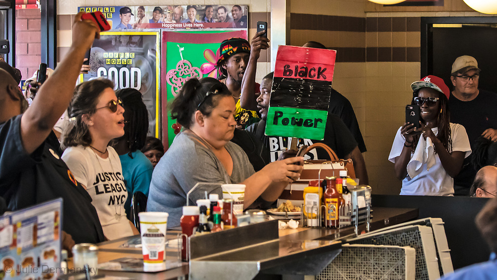 Patron in Waffle House idealing with protesters who took it over briefly.