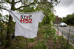 © Licensed to London News Pictures. 28/04/2019. London, UK. A Stop HS2 t-shirt hangs from a tree as Extinction Rebellion activists join with Stop HS2 protestors to occupy trees in Colne Valley to stop their felling for the HS2 rail project. Workers were expected to start cutting down the trees yesterday and to continue today but the protests have stopped the work. Photo credit: Peter Macdiarmid/LNP