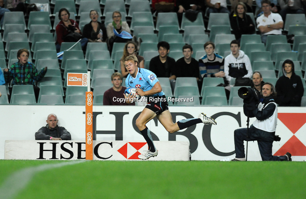 17.03.2012 Sydney, Australia.Waratahs winger Tom Kingston scores a try during the FxPro Super Rugby game between the New South Wales Waratahs  and Western Force at the Allianz Stadium,Sydney.