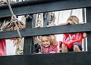Joyce Odum, 3; Reagan Durocher, 4; and A.J. Durocher, 6; explore the upper deck of the Pinta Thursday afternoon at the Columbus Marina. The ship, a replica of one of the three vessels Italian explorer Christopher Columbus sailed on his 1492 voyage, will be in Columbus through Monday as part of a floating museum tour.  (Photo by Carmen K. Sisson/Dispatch Staff)