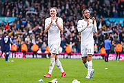 Leeds United defender Luke Ayling (2) and Leeds United forward Tyler Roberts (11) reacts during the EFL Sky Bet Championship match between Leeds United and Huddersfield Town at Elland Road, Leeds, England on 7 March 2020.