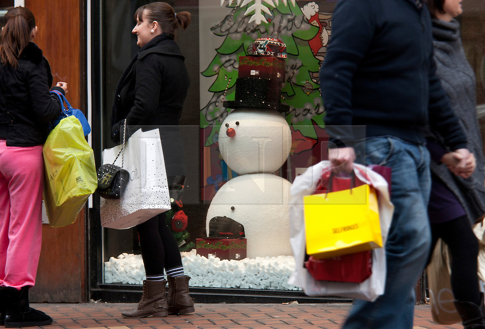 © under licence to London News Pictures 12/12/2010 Christmas shoppers were out in force today (Sunday) as car parks were full and the streets packed with shoppers looking for Christmas presents. Picture shows a snowman in one of the shop windows on Corporation Street, Birmingham City Centre..Picture credit: Dave Warren/London News Pictures...