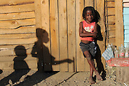 A young boy in Batey II in Mao, Dominican Republic. Her community recently launched a campaign to help resolve conflicts in their community. The center formally opens three times a week but facilitators are always available within the community to intervene when problems arise. As undocumented Haitians living in the Dominican Republic their rights are limited. Before the community banded together they often fell victim to police officers that would come and blackmail them with deportation for money. Since they formed their group they no longer face such problems. The incidence of violent attacks has fallen drastically.  Sara A. Fajardo/CRS