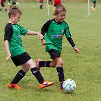 Darragh Ball runs clear with ball at the Avenue Utd Summer Soccer Camp