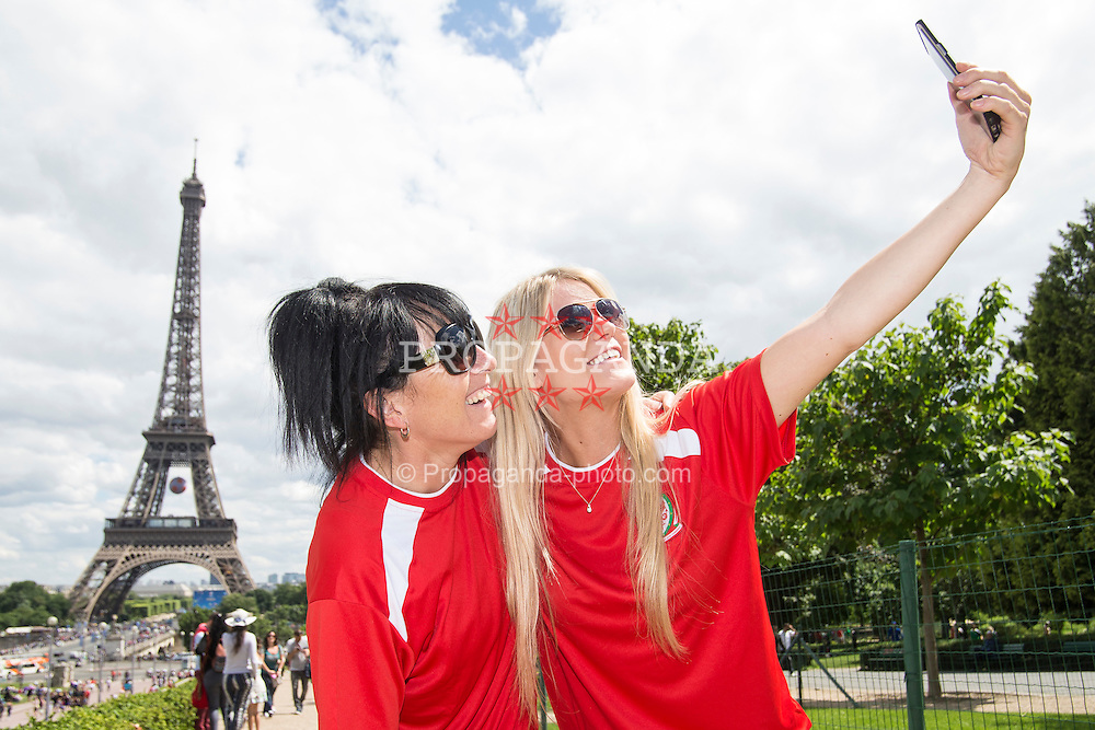 PARIS, FRANCE - Saturday, June 25, 2016: Wales supporters Tracey Roberts, left, and Georgia Milton pose for a selfie infront of the Eiffel Tower, Paris ahead of the match against Northern Ireland during the Round of 16 UEFA Euro 2016 Championship at the Parc des Princes. (Pic by Paul Greenwood/Propaganda)