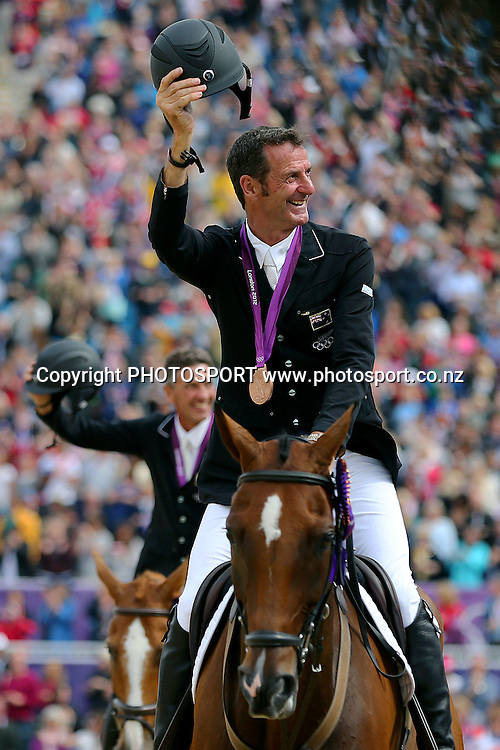 Mark Todd followed by Andrew Nicholson with their Bronze Medal for Eventing Team Jumping. Olympic Equestrian Eventing, Jumping Final, Greenwich Park, London, United Kingdom. Tuesday 31st July 2012. Photo: Anthony Au-Yeung / photosport.co.nz