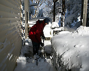 DAVE MORRIS shovels a sidewalk at his home in Alden, New York, USA on Wednesday, November 19, 2014. Up to six feet of snow fell on the region Tuesday, stranding dozens of motorists on roadways and causing at least six deaths.