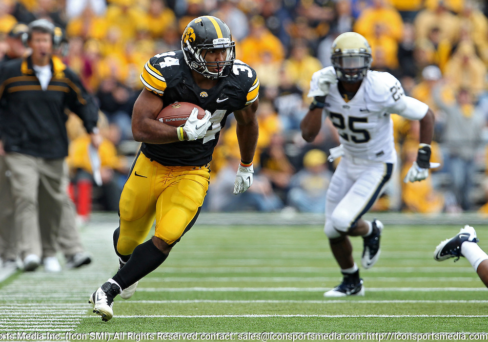 September 17, 2011: Iowa Hawkeyes running back Marcus Coker (34) on a run during the second half of the game between the Iowa Hawkeyes and the Pittsburgh Panthers at Kinnick Stadium in Iowa City, Iowa on Saturday, September 17, 2011. Iowa defeated Pittsburgh 31-27.