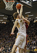 December 31 2012: Indiana Hoosiers forward Will Sheehey (0) puts up a shot around Iowa Hawkeyes center Adam Woodbury (34) during the second half of the NCAA basketball game between the Indiana Hoosiers and the Iowa Hawkeyes at Carver-Hawkeye Arena in Iowa City, Iowa on Monday December 31, 2012. Indiana defeated Iowa 69-65.