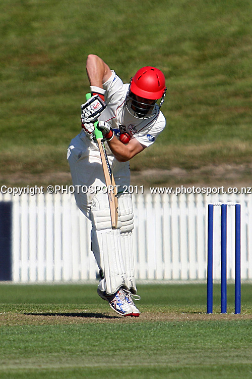 Henry Nicholls gets a short ball to the ribs during the plunket shield cricket match between the Northern Knights and Canterbury Wizards . Domestic 4 day cricket, Seddon Park, Hamilton. 29 November 2011. Photo: Dion Mellow / photosport.co.nz