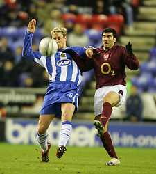 WIGAN, ENGLAND - TUESDAY, JANUARY 10th, 2006: Wigan Athletic's Stephane Henchoz and Arsenal's Jose Antonio Reyes during the League Cup match at the JJB Stadium. (Pic by David Rawcliffe/Propaganda)