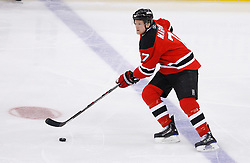 Jan 21, 2008; Newark, NJ, USA; New Jersey Devils defenseman Paul Martin (7) skates with the puck during the third period at the Prudential Center. The Devils defeated the Canadiens 5-2.