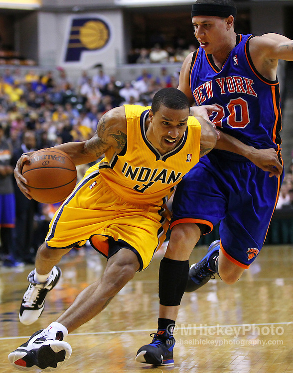 April 03, 2012; Indianapolis, IN, USA; Indiana Pacers shooting guard George Hill (3) dribbles past New York Knicks point guard Mike Bibby (20) at Bankers Life Fieldhouse. Mandatory credit: Michael Hickey-US PRESSWIRE