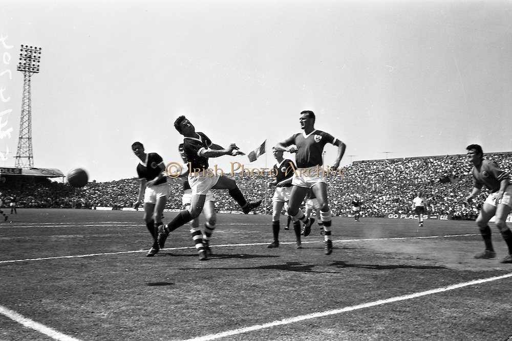 09/06/1963<br /> 06/09/1963<br /> 09 June 1963<br /> Soccer International: Ireland v Scotland at Dalymount Park Dublin. Ireland won the game 1-0 with a goal from Captain Noel Cantwell. Cantwell v the rest! But in this case the rest were too strong for Cantwell (right centre) to convert a corner kick into a goal.