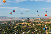 Hot air balloons drift over Reno, Nevada, during The Great Reno Balloon Race Preview Day on Thursday, September 7, 2017. The three-day event officially kicks off tomorrow, September 8.<br /> <br /> The Great Reno Balloon Race is the largest free hot-air ballooning event in the world. An average of 120,000 spectators attend the event each year.