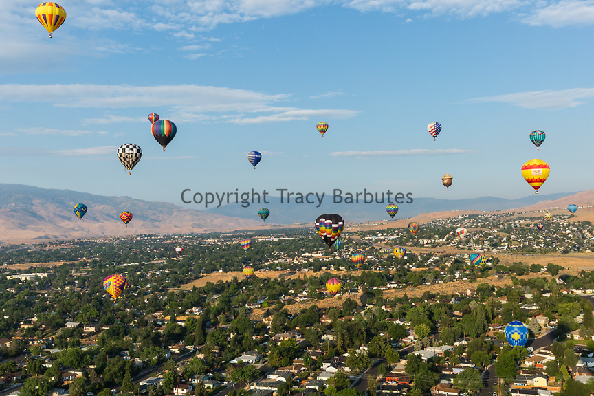 Hot air balloons drift over Reno, Nevada, during The Great Reno Balloon Race Preview Day Launch on Thursday, September 7, 2017. The three-day event officially kicks off tomorrow, September 8.<br /> <br /> The Great Reno Balloon Race is the largest free hot-air ballooning event in the world. An average of 120,000 spectators attend the event each year.