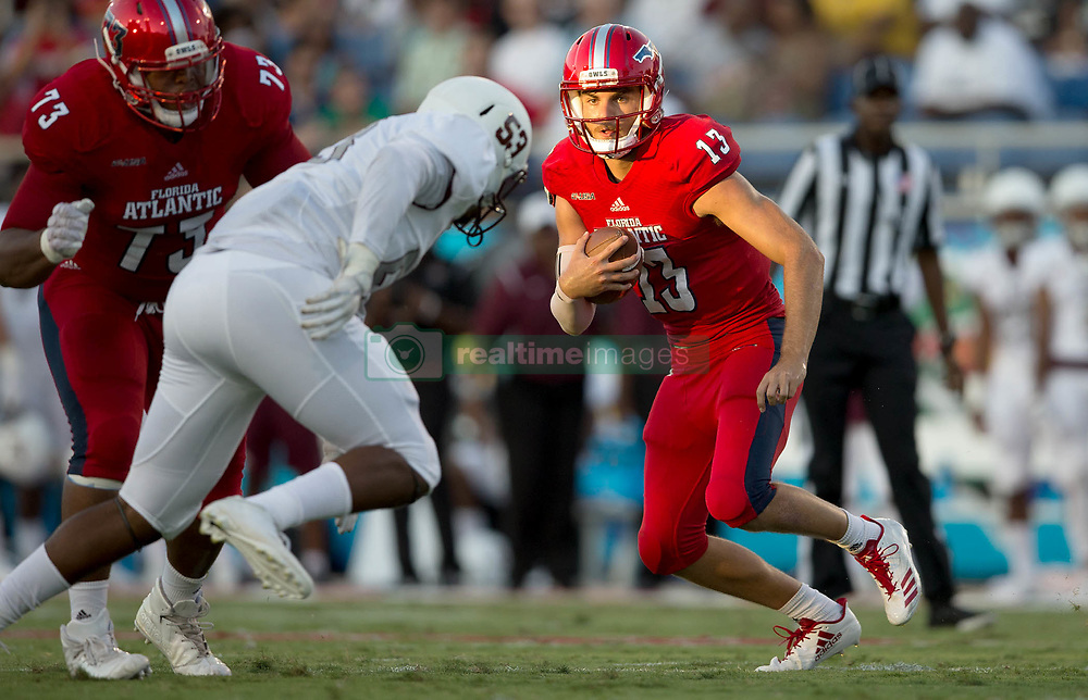 September 16, 2017 - Boca Raton, Florida, U.S. - Florida Atlantic Owls quarterback Daniel Parr (13) follows the block of offensive lineman Brandon Walton (73) on a nine yard touchdown run against Bethune Cookman Wildcats in Boca Raton, Florida on September 16, 2017. (Credit Image: © Allen Eyestone/The Palm Beach Post via ZUMA Wire)
