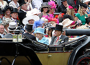 © Licensed to London News Pictures. 19/06/2012. Ascot, UK  HRH Queen Elizabeth II and HRH The Duke of Edinburgh arrive in the Parade Circle. Day one at Royal Ascot 19 June 2012. Royal Ascot has established itself as a national institution and the centrepiece of the British social calendar as well as being a stage for the best racehorses in the world.. Photo credit : Stephen Simpson/LNP