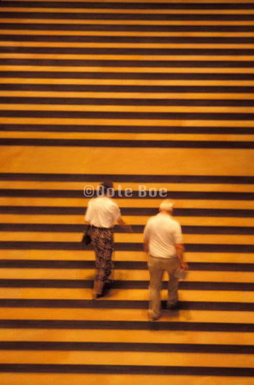 Elderly couple walking up steps