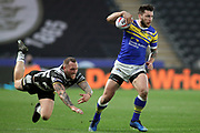 Hull FC back row forward Dean Hadley (11) attempts to tackle Leeds Rhinos winger Tom Briscoe (2)  during the Betfred Super League match between Hull FC and Leeds Rhinos at Kingston Communications Stadium, Hull, United Kingdom on 19 April 2018. Picture by Mick Atkins.