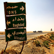 """Homs or Baghdad"" Sign post on the road to Palmyra.  Syria. ""Homs ou Baghdad"" Panneau de signalisation sur la route de Palmyre, Syrie."