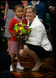 Sofia Jardine-Kerr presents The Countess of Wessex flowers on The Earl of Wessex on his 50th Birthday as The Earl and Countess of Wessex, Founders of the Wessex Youth Trust, visit The Robert Browning Primary School, Walworth, London, United Kingdom, to see the work of youth charity Kidscape, Monday, 10th March 2014. Picture by Andrew Parsons / i-Images
