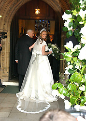 The bride CLEMENTINE HAMBRO with her father RICHARD HAMBRO  at the wedding of Clementine Hambro to Orlando Fraser at St.Margarets Westminster Abbey, London on 3rd November 2006.<br />