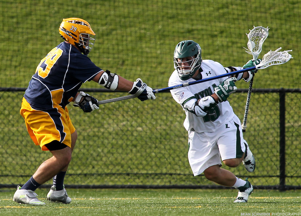 May 12, 2012; Baltimore, MD, USA; Canisius College Golden Griffins Adam Donner (39) against Loyola Maryland Greyhounds attack Justin Ward (15) at Ridley Athletic Complex in Baltimore, MD. Mandatory Credit: Brian Schneider-www.ebrianschneider.com