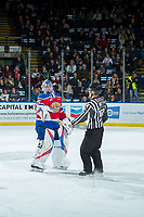 KELOWNA, CANADA - FEBRUARY 17:  Linesman Dustin Minty brings Todd Scott #35 of the Edmonton Oil Kings a new stick against the Kelowna Rockets on February 17, 2018 at Prospera Place in Kelowna, British Columbia, Canada.  (Photo by Marissa Baecker/Shoot the Breeze)  *** Local Caption ***