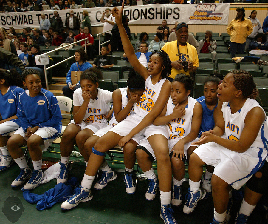 03/13/2010 - Jefferson teammates celebrate on their bench after they beat Wilsonville 50-40 in the 2010 OSAA 5A Basketball State Championship game from Mac Court on the University of Oregon.