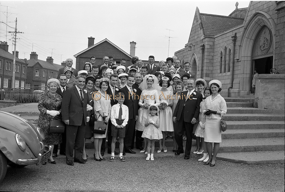 28/07/1962<br /> 07/28/1962<br /> 28 July 1962 <br /> Wedding of Mr Desmond F. English, Landscape Cresent, Churchtown and Miss Blanche O'Brien Oakley Park, Blackrock at St John the Baptist Church, Blackrock and Ross's Hotel Dun Laoghaire, Dublin. Image shows the wedding party outside the church.