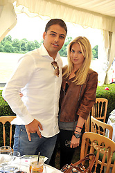 MARISSA MONTGOMERY and JAMIE REUBEN at a charity polo match organised by Jaeger Le Coultre was held at Ham Polo Club, Richmond, Surrey on 12th June 2009.