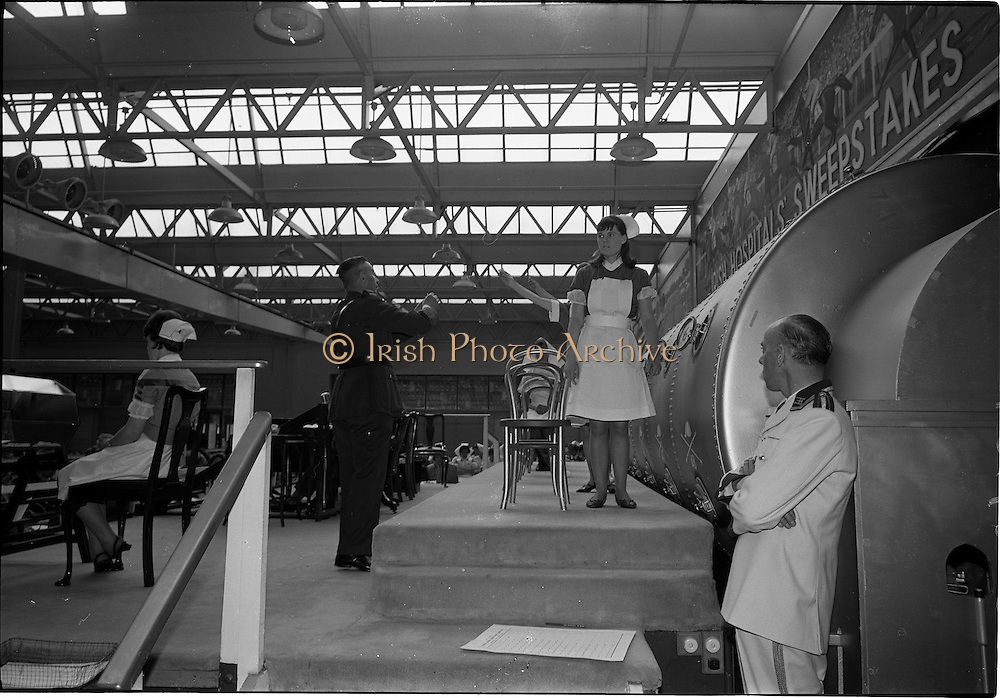 28/06/1967<br /> 06/28/1967<br /> 28 June 1967<br /> Irish Sweepstakes Derby Draw at Irish Hospital Sweepstakes office, Ballsbridge, Dublin. Image shows some of the nurses with the numbers they have taken from the drum, waiting for Chief Superintendent J. McDonagh of Garda headquarters to take them.