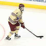 Teddy Doherty #4 of the Boston College Eagles controls the puck during The Beanpot Championship Game at TD Garden on February 10, 2014 in Boston, Massachusetts. (Photo by Elan Kawesch)