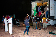 Men removing sound equipment from a lorry at Middle East Tek, Wadi Rum, Jordan, 2008