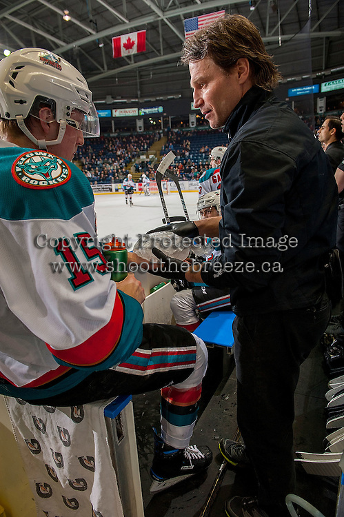 KELOWNA, CANADA - MARCH 1: Kelowna Rockets' athletic therapist, Scott Hoyer, gets ice for Tomas Soustal #15 of the Kelowna Rockets after a first period injury against the Prince George Cougars on MARCH 1, 2017 at Prospera Place in Kelowna, British Columbia, Canada.  (Photo by Marissa Baecker/Shoot the Breeze)  *** Local Caption ***