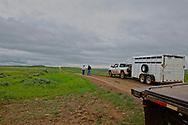 John L. Moore, Wally Badgett, neighbor, planning gathering, cattle branding, Lazy TL Ranch, north of Miles City, Montana