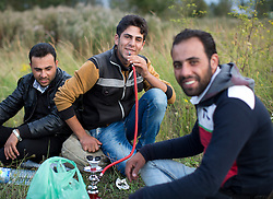© Licensed to London News Pictures. 29/08/2015. Calais, France. A group of refugees from Syria take a break on their walk towards the perimeter fences to attempt their way out to UK through the Channel Tunnel in Frethun, near Calais. Photo credit : Isabel Infantes/LNP