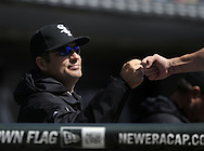 CHICAGO - APRIL 03:  Manager Robin Ventura #23 fist bumps Adam Dunn #32 of the Chicago White Sox after Dunn hit a home run in the second inning against the Kansas City Royals on April 3, 2013 at U.S. Cellular Field in Chicago, Illinois.  The White Sox defeated the Royals 5-2.  (Photo by Ron Vesely)   Subject: Robin Ventura; Adam Dunn