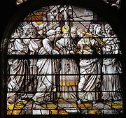 The Marriage of the Virgin, with Joseph holding his flowering rod, the holy spirit above and the high priest performing the ceremony, from the Life of the Virgin and the Childhood of Christ grisaille stained glass window with silver and gold on white glass, 1545, by the School of Fontainebleau, in the South chapel choir of the Collegiate Church of Saint-Gervais-Saint-Protais, built 12th to 16th centuries in Gothic and Renaissance styles, in Gisors, Eure, Haute-Normandie, France. The church was consecrated in 1119 by Calixtus II but the nave was rebuilt from 1160 after a fire. The church was listed as a historic monument in 1840. Picture by Manuel Cohen