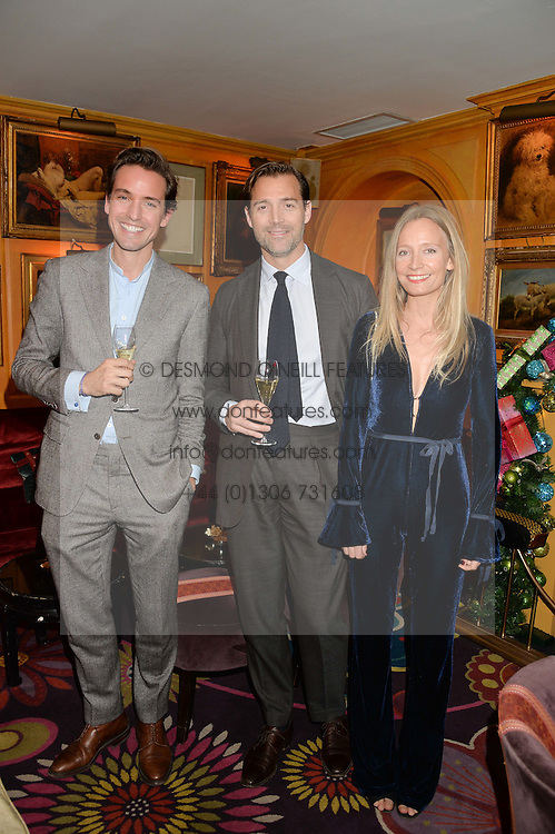 Left to right, ALEXANDER GILKES, PATRICK GRANT and MARTHA WARD at a Thanksgiving dinner hosted by Alexander Gilkes of Paddle8 at Annabel's, 44 Berkeley Square, London on 23rd November 2016.