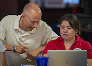 Teachers participate in PowerUp training at the High School for Law Enforcement and Criminal Justice, August 13, 2014.